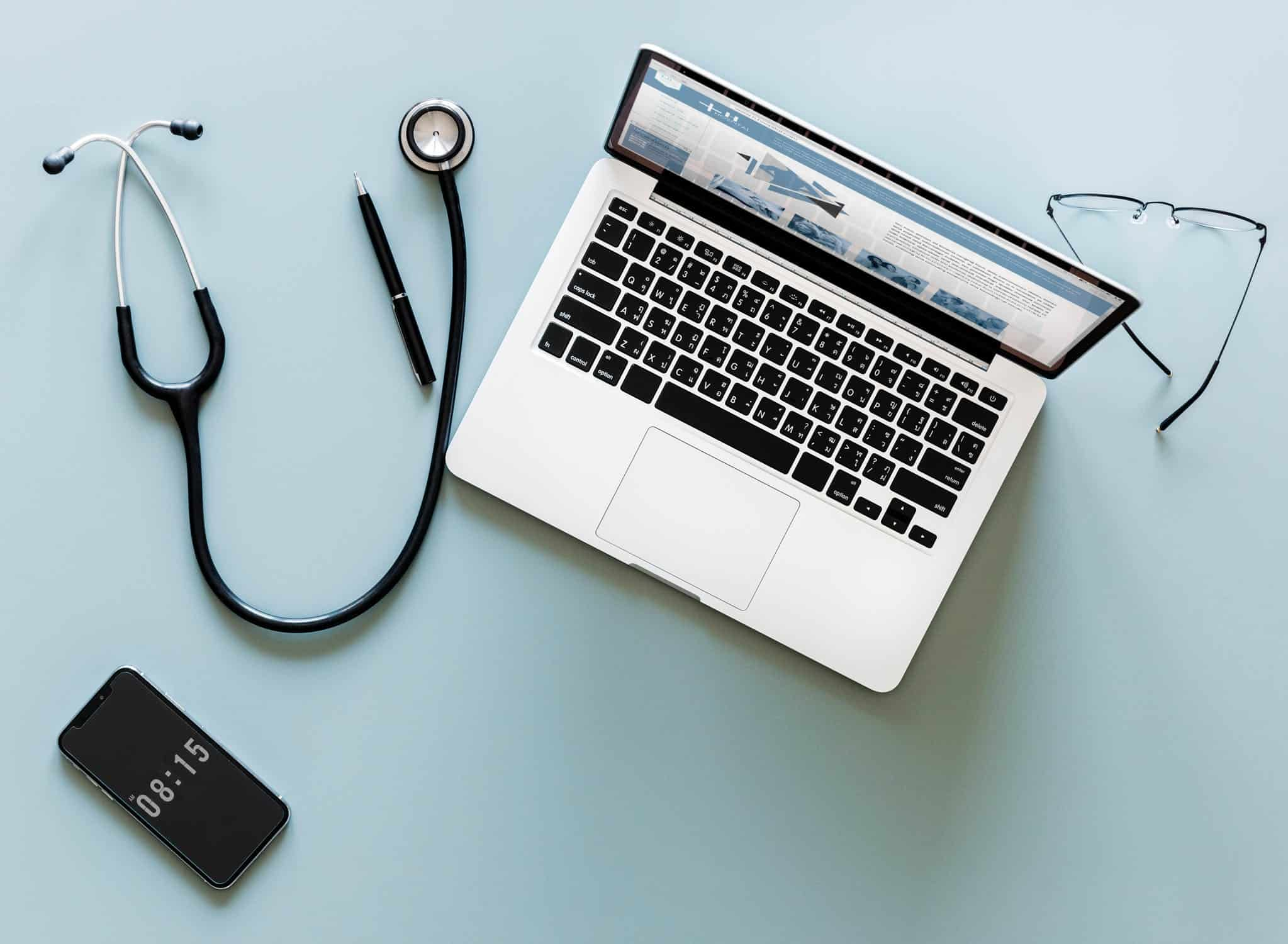 laptop phone and Stethoscope